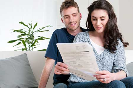 couple looking at tax paper